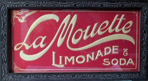 La Mouette; vintage embossed store advertising sign; c.1900